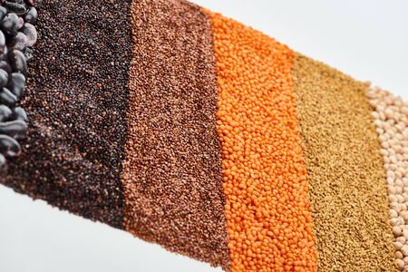 uncooked red lentil, buckwheat, quinoa, and chickpea isolated on white