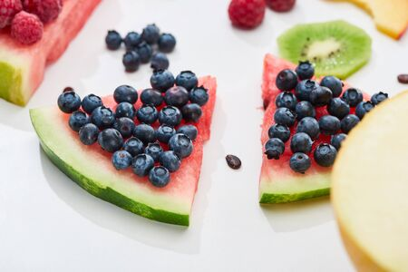 delicious dessert with watermelon and blueberries on white background