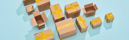 panoramic shot of postal boxes on blue background with copy space Stock Photo