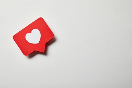 red paper like card on white surface