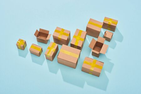 top view of cardboard boxes on blue background with copy space Stock Photo