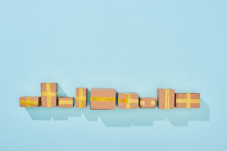 top view of closed cardboard boxes with shadow on blue background with copy space Stock Photo