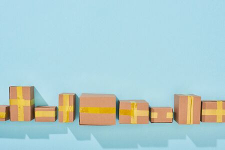 top view of closed cardboard boxes with shadow on blue background Stock Photo