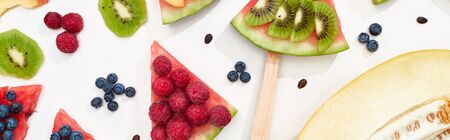panoramic shot of tasty watermelon with seasonal berries and fruits on white background