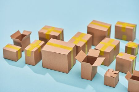 postal cardboard boxes on blue background with copy space Stock Photo