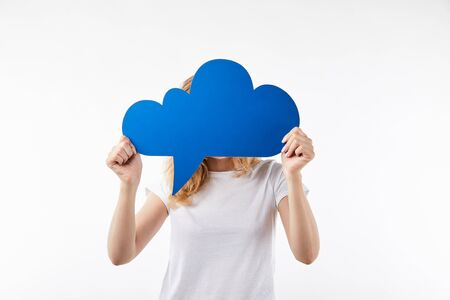 woman with blue thought bubble in hands standing isolated on white Stock Photo