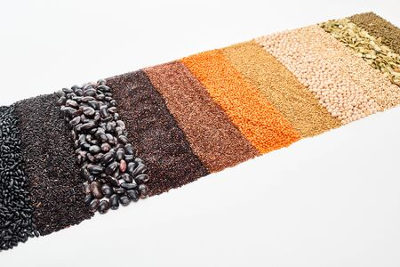 black beans, rice, quinoa, chickpea, pumpkin seeds, buckwheat, maash and red lentil isolated on white