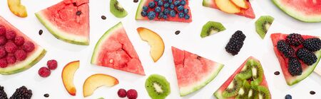 panoramic shot of delicious watermelon with seasonal berries and fruits on white background 写真素材