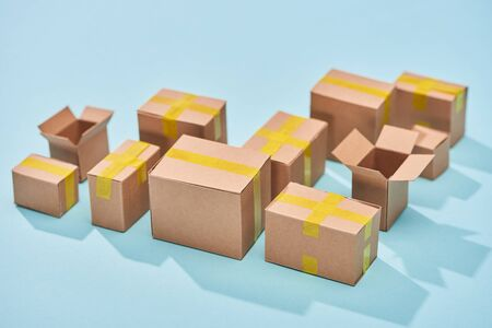 cardboard boxes on blue background with copy space Stock Photo