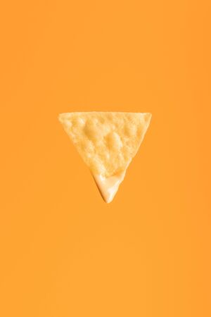 top view of crispy nacho isolated on orange, Mexican cuisine Stock Photo