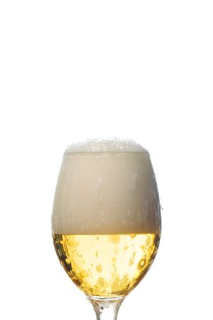 wet glass of beer with white foam isolated on white Imagens