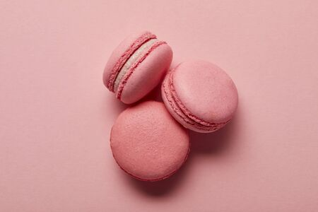 Tasty sweet pink french macaroons on pink background 写真素材 - 130575107