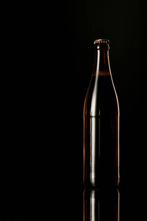 glass bottle of beer isolated on black
