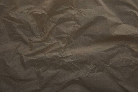 top view of dark beige crumped parchment paper surface with copy space