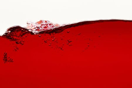 ripple red bright liquid with bubbles isolated on white