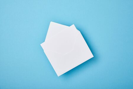 envelope with blank white card on blue background