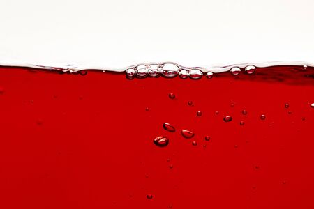 red bright liquid with bubbles on surface isolated on white Stock Photo - 130601957