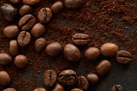 Aromatic roasted coffee beans mixed with ground coffee 写真素材