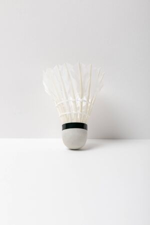 white badminton shuttlecock on white background with copy space