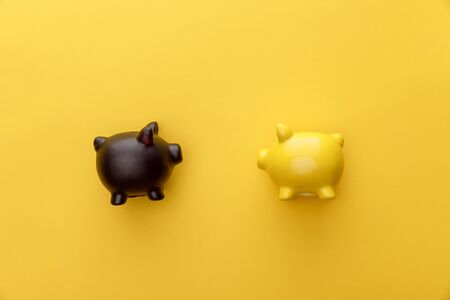 top view of piggy banks on yellow background