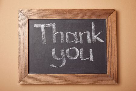 chalkboard with thank you lettering on beige background 版權商用圖片
