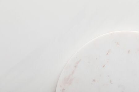 Clean light round marble surface on white background 스톡 콘텐츠