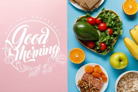 top view of diet food on blue and pink background with good morning lettering Фото со стока