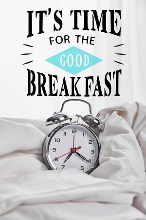 silver alarm clock in blanket in white bed with its time for the good breakfast illustration