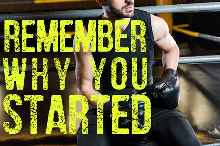 cropped view of man in boxing gloves holding sport bottle in gym with remember why you started illustration