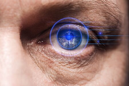 close up view of human eye with data illustration, robotic concept 写真素材