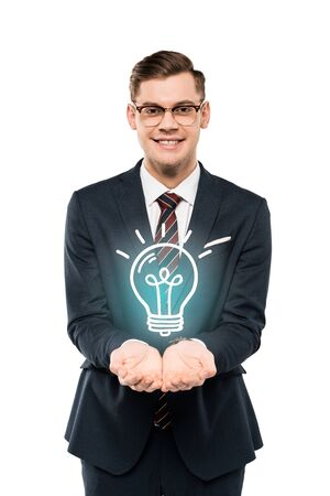 cheerful businessman in glasses with cupped hands light bulb isolated on white