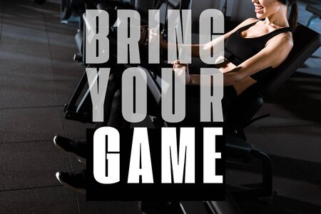 cropped view of athletic woman exercising on training apparatus in gym with bring your game illustration