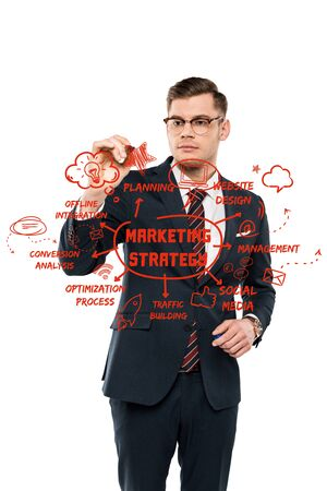 handsome businessman in glasses holding marker pen near planning lettering on white Stock Photo