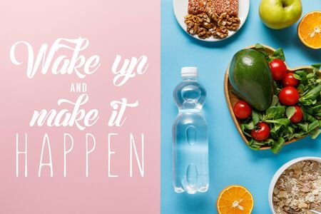 top view of fresh fruits, crispbread and breakfast cereal on blue and pink background with wake up and make it happen lettering Reklamní fotografie