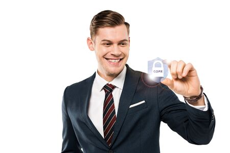happy businessman gesturing and smiling while looking at padlock with gdpr lettering on while Stock Photo