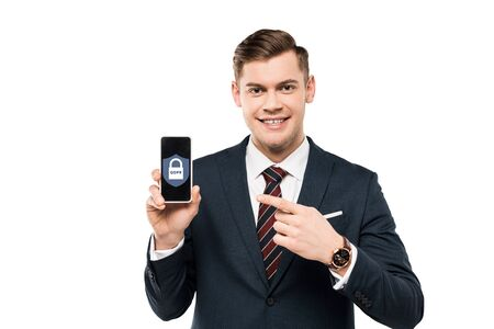 happy businessman in suit pointing with finger at smartphone with gdpr lettering on screen  isolated on white