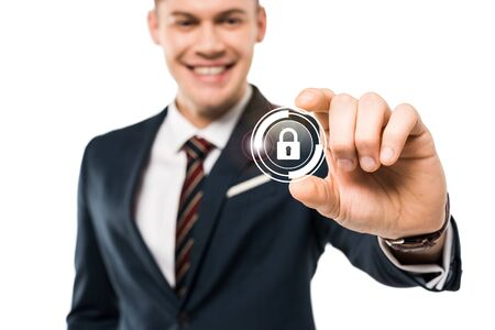 selective focus of happy businessman gesturing and smiling while touching virtual padlock isolated on while