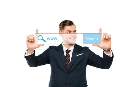 positive businessman pointing with fingers at address bar on white