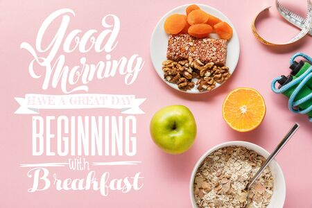 top view of fresh diet food, measuring tape, skipping rope on pink background with good morning, have a great day beginning with breakfast lettering Reklamní fotografie