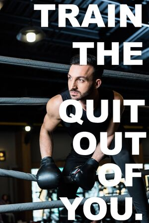 handsome athletic man in boxing gloves standing near ropes in boxing ring with train the quit out of you illustration Banque d'images - 130885868