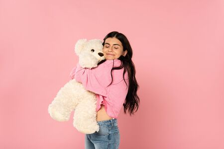 beautiful happy girl hugging teddy bear, Isolated On pink