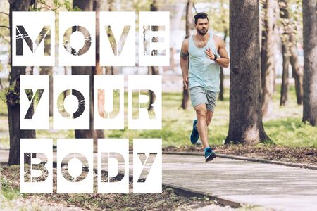 handsome man in sportswear running along walkway in sunny park with move your body lettering
