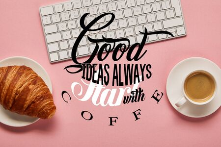 top view of computer keyboard near coffee and croissant on pink background with good ideas always start with coffee illustration 版權商用圖片