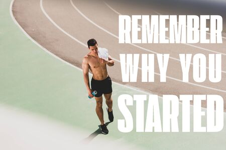 full length view of mixed race sportsman holding towel and sport bottle at stadium with remember why you started lettering