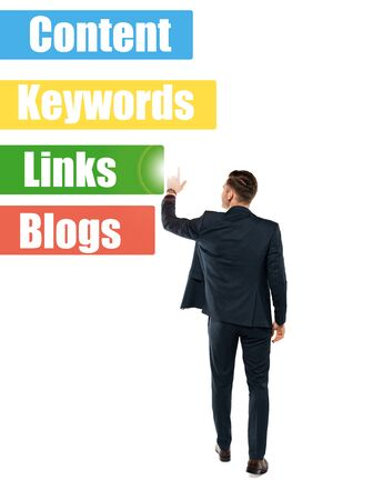 back view of man pointing with finger at links lettering while standing on white Stock Photo