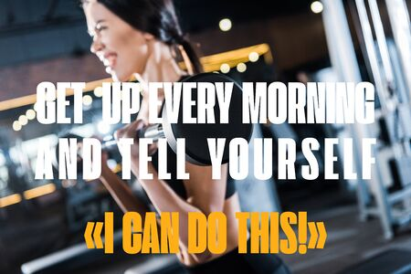 selective focus of young woman working out with heavy barbell in gym with get up every morning and tell yourself you can do this illustration