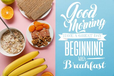 top view of fresh fruits, crispbread and breakfast cereal on blue and pink background with good morning, have a great day beginning with breakfast lettering Imagens - 130886422
