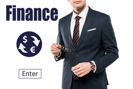 cropped view of businessman in suit holding glasses near finance lettering on white Stock Photo