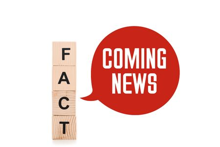black fact word made of wooden blocks near red speech bubbles with coming news lettering isolated on white