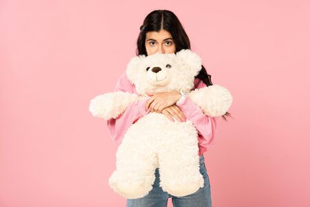 happy attractive girl hugging teddy bear, Isolated On pink